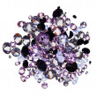 Many small purple diamond (jewel) stones heap isolated on white — Stock Photo #7979225