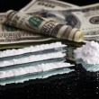 Cocaine drugs heap still life on a mirror with rolled 100 dollar — Stock Photo #8407257