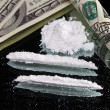 Cocaine drugs heap still life on a mirror with rolled 100 dollar — Stock Photo