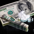 Cocaine drugs heap still life on a mirror with rolled 100 dollar — Stock Photo #8407262