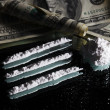 Cocaine drugs heap still life on a mirror with rolled 100 dollar — Stock Photo #8407272