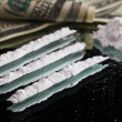 Cocaine drugs heap still life on a mirror with rolled 100 dollar — Stock Photo #8407275