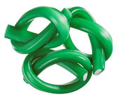 Green gummy candy (licorice) rope set, isolated on white closeup — Stock Photo