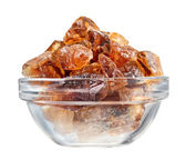 Brown lump cane sugar heap in glass bowl, isolated on white — Stock Photo