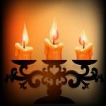 Three burning candles on dark background — Stock Vector