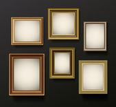 Picture frames set on wall — Stockvector