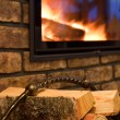Stock Photo: Fire wood against a fireplace