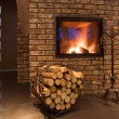 Fire wood against a fireplace — Stock Photo #8948961