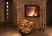 Fire wood against a fireplace — Stock fotografie