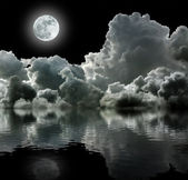 Moon in black stormy clouds — Stock Photo
