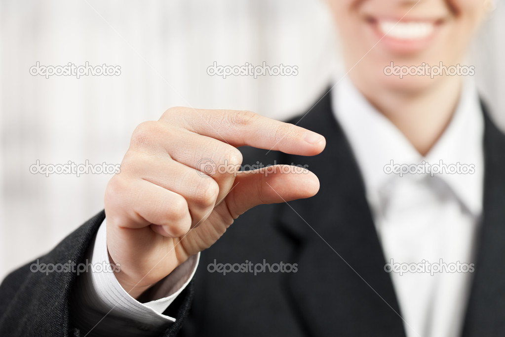 Beauty smiling business woman showing pinch finger sign  Stock Photo #10019832