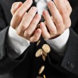 Spilling coins in hands — Stock Photo