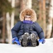 Child sled on snow hill — Stock Photo