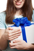 Woman hand holding gift or present box — Стоковое фото