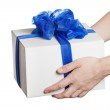 Human hand holding gift or present box — Stock Photo