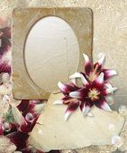 Grunge frame with lilys and paper — Stock Photo