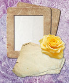 Grunge frame with yellow rose and paper — Stock Photo