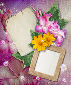 Grunge frame with gladiolus and paper — Stock Photo