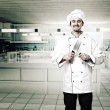 Chef in kitchen - Stock Photo
