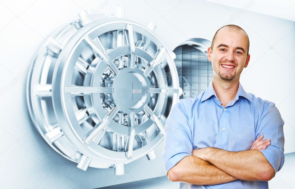 Smiling man and vault door background — Stock Photo #9239565