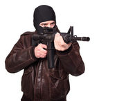 Terrorist with rifle — Stock Photo