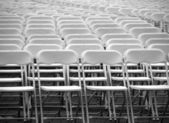 A Multitude of White Plastic Chairs — Stock Photo
