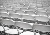 Sea of White Plastic Chairs — Stock Photo