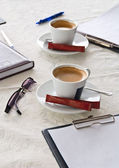 Morning workplace: cup of coffee and business objects — Stock Photo