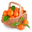 Royalty-Free Stock Photo: Ripe tangerines with leaves in basket