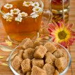 Cane brown sugar and herbal tea — Stock Photo