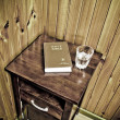 Bible on bed side table - Stock Photo