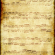 Royalty-Free Stock Photo: Music notes on old paper