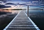 Pontoon jetty across the water — Stock Photo
