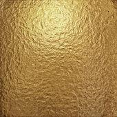 Fine crinkled gold aluminium foil — Stock Photo