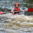 Teenager white water kayaking — Stock Photo
