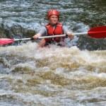 Teenager white water kayaking — Stock Photo