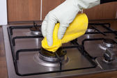 Hand cleaning stove. — Stock Photo