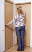 Woman and doors. — Stock Photo