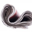 Rolled up newspaper. — Stock Photo