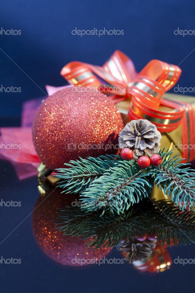 2012 Christmas gift with red  bauble and twig of Christmas tree.  Stock Photo #8057345