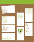 Set of floral cards on wooden background for your design — Cтоковый вектор