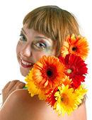 Flicka med blommor — Stockfoto