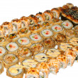 Hot sushi and sushi rolls — Stock Photo #8087902