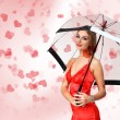 Pretty young woman with umbrella and hearts — Stock Photo #10028032