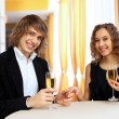 Stock Photo: Couple in a restaurant with shampagne