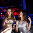 Young woman in night club with a drink — Stock Photo #10028580