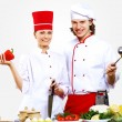Portrait of a young cook in uniform - Stock Photo