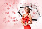 Hezká mladá žena s deštníkem a srdce — Stock fotografie