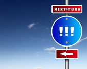 Road sign agaisnt blue sky — Stock Photo
