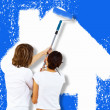 Young couple with paint brushes together — Stock Photo